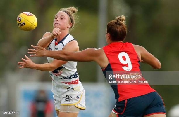 Dayna Cox of the Crows handpasses the ball during the 2017 AFLW Round 06 match between the Adelaide Crows and the Melbourne Demons at TIO Stadium on...