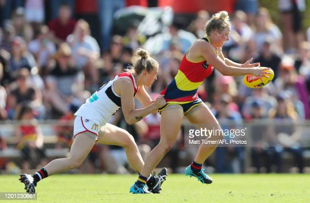 Dayna Cox of the Crows is tackled by Darcy Guttridge of the Saints during the 2020 AFLW Round 02 match between the Adelaide Crows and the St Kilda...