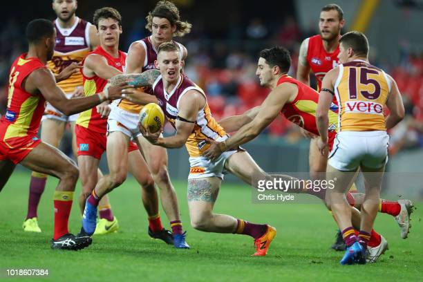 Tom Cutler of the Lions kicks during the round 22 AFL match between the Gold Coast Suns and Brisbane Lions at Metricon Stadium on August 18 2018 in...
