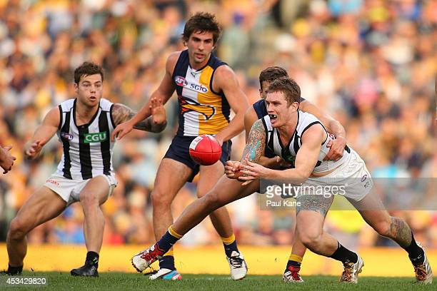 Dayne Beams of the Magpies handballs during the round 20 AFL match between the West Coast Eagles and the Collingwood Magpies at Patersons Stadium on...