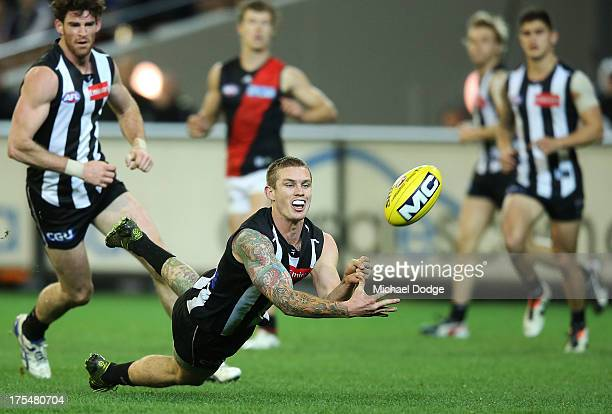 Dayne Beams of the Magpies handpasses the ball during the round 19 AFL match between the Collingwood Magpies and the Essendon Bombers at Melbourne...