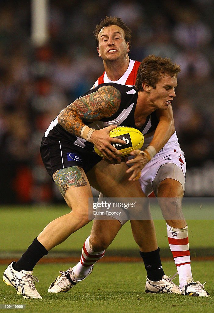 Dayne Beams of the Magpies is tackled by Jude Bolton of the Swans during the NAB Cup Quarter Final match between the Collingwood Magpies and the Sydney Swans at Etihad Stadium on February 25, 2011 in Melbourne, Australia.