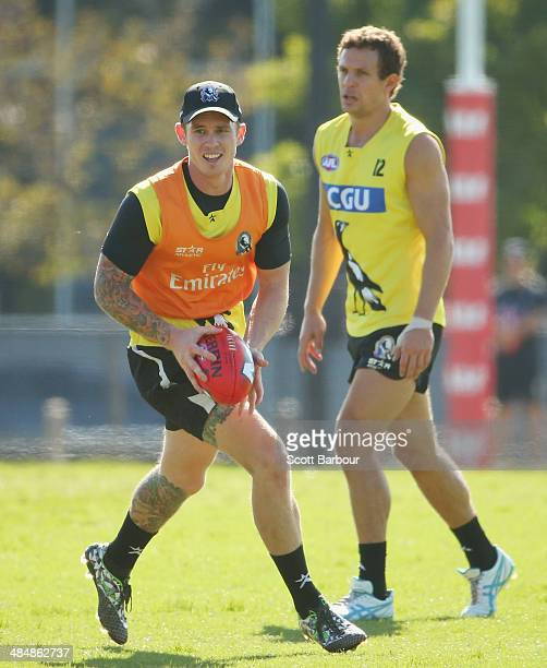 Dayne Beams runs with the ball as Luke Ball of the Magpies looks on during a Collingwood Magpies AFL training session at Olympic Park on April 15...