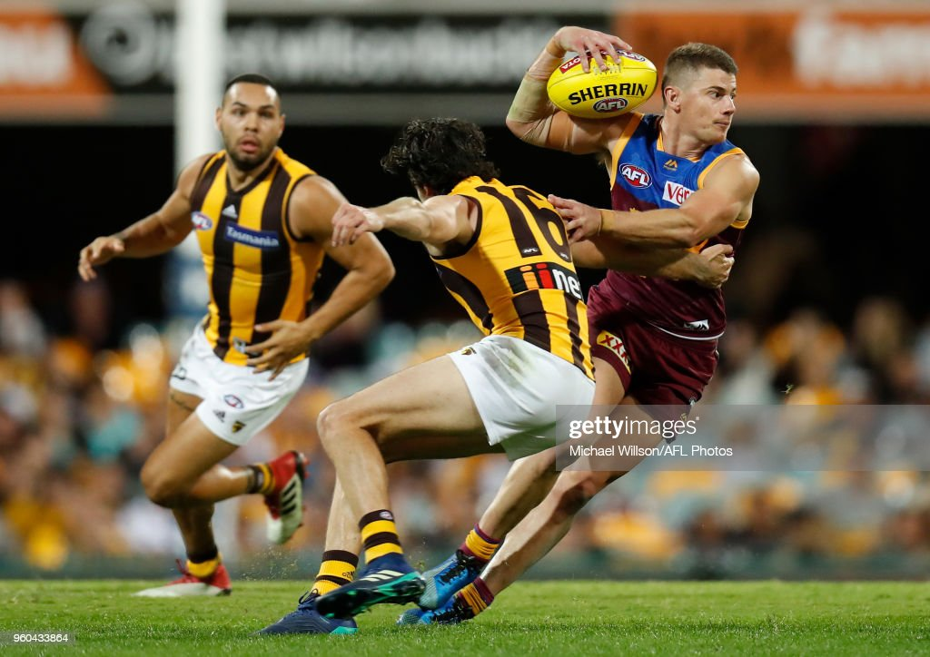 Dayne Zorko of the Lions and Isaac Smith of the Hawks in action during the 2018 AFL round nine match between the Brisbane Lions and the Hawthorn Hawks at the Gabba on May 20, 2018 in Brisbane, Australia.
