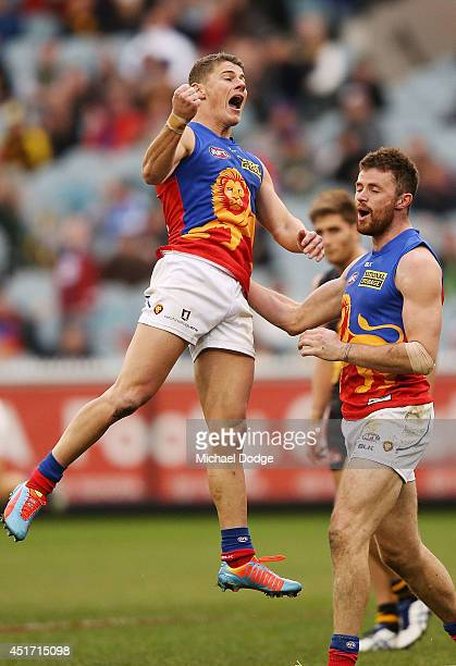 Dayne Zorko of the Lions celebrates a goal with Pearce Hanley of the Lions during the round 16 AFL match between the Richmond Tigers and the Brisbane...