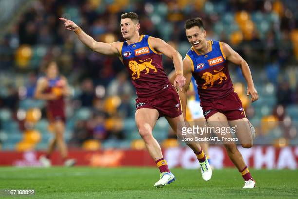 Dayne Zorko of the Lions celebrates his goal with Hugh McCluggage of the Lions during the round 21 AFL match between the Brisbane Lions and the Gold...