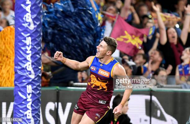 Dayne Zorko of the Lions celebrates kicking a goal during the round 15 AFL match between the Brisbane Lions and the Melbourne Demons at The Gabba on...