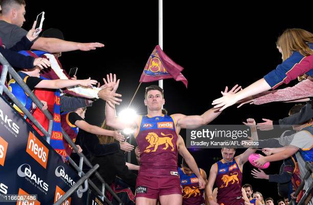 Dayne Zorko of the Lions celebrates victory with the fans after the round 20 AFL match between the Brisbane Lions and the Western Bulldogs at The...