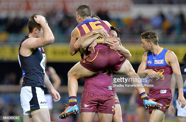 Dayne Zorko of the Lions celebrates with team mate Allen Christensen during the round 20 AFL match between the Brisbane Lions and the Carlton Blues...
