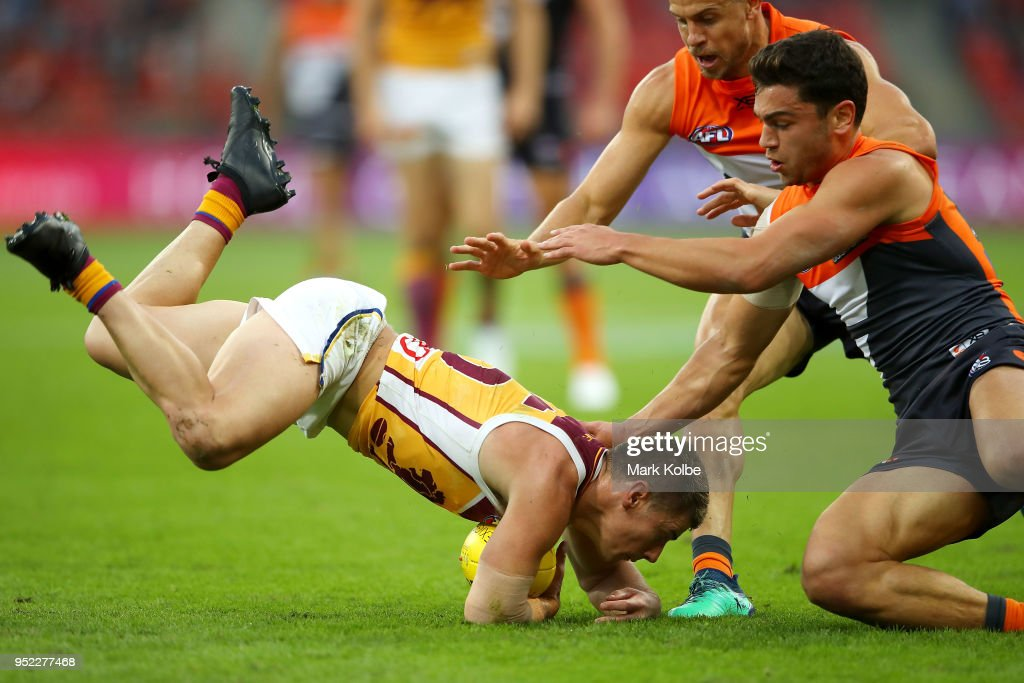 Dayne Zorko of the Lions is tackled during the round six AFL match between the Greater Western Sydney Giants and the Brisbane Lions at Spotless Stadium on April 28, 2018 in Sydney, Australia.