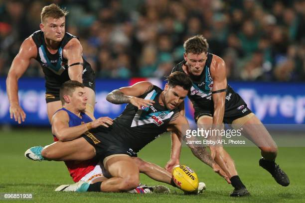 Dayne Zorko of the Lions tackles Chad Wingard of the Power during the 2017 AFL round 13 match between Port Adelaide Power and the Brisbane Lions at...