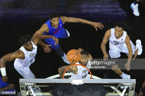 Dayon Griffin Chad Brown Terrell Allen of the UCF Knights watch the ball as they attempt an offensive rebound during a NCAA basketball game against...