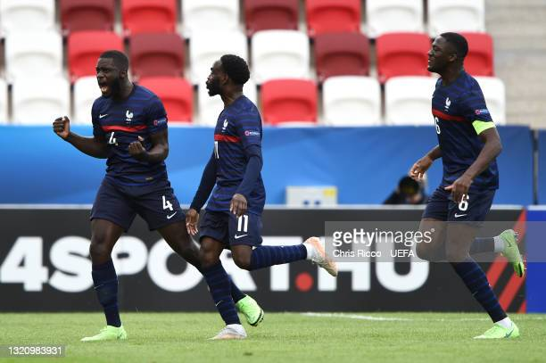 Dayot Upamecano of France celebrates with Jonathan Ikone after scoring their side's first goal during the 2021 UEFA European Under-21 Championship...