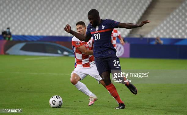 Dayot Upamecano of France in action with Andrej Kramaric of Crotia during the UEFA Nations League group stage match between France and Croatia at...