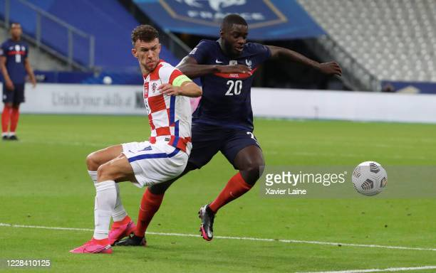 Dayot Upamecano of France in action with captain Ivan Perisic of Crotia during the UEFA Nations League group stage match between France and Croatia...