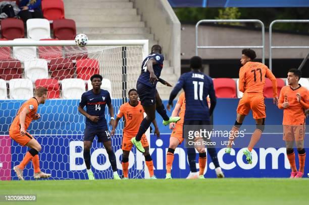 Dayot Upamecano of France scores their side's first goal during the 2021 UEFA European Under-21 Championship Quarter-finals match between Netherlands...