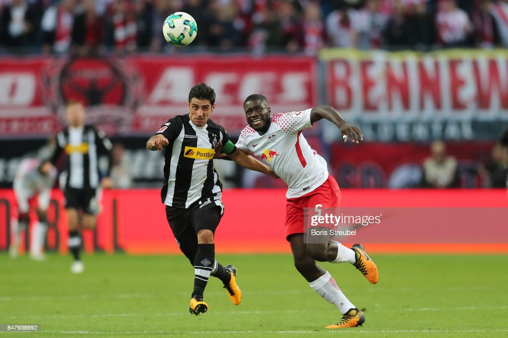 Dayot Upamecano of Leipzig (r) fights for the ball with Jonas Hofmann of Moenchengladbach during the Bundesliga match between RB Leipzig and Borussia Moenchengladbach at Red Bull Arena on September 16, 2017 in Leipzig, Germany.
