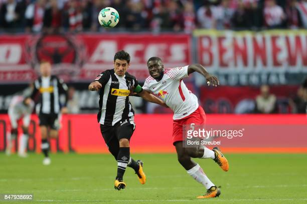 Dayot Upamecano of Leipzig fights for the ball with Jonas Hofmann of Moenchengladbach during the Bundesliga match between RB Leipzig and Borussia...