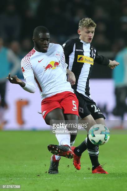 Dayot Upamecano of Leipzig fights for the ball with Mickael Cuisance of Moenchengladbach during the Bundesliga match between Borussia...