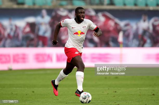 Dayot Upamecano of Leipzig runs with the ball during the Bundesliga match between RB Leipzig and Hertha BSC at Red Bull Arena on May 27, 2020 in...