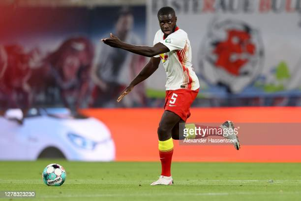 Dayot Upamecano of Leipzig runs with the ball during the Bundesliga match between RB Leipzig and FC Schalke 04 at Red Bull Arena on October 03, 2020...