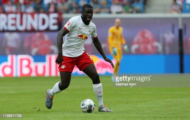 Dayot Upamecano of Leipzig runs with the ball during the pre-season friendly match between RB Leipzig and Aston Villa at Red Bull Arena on August 3,...