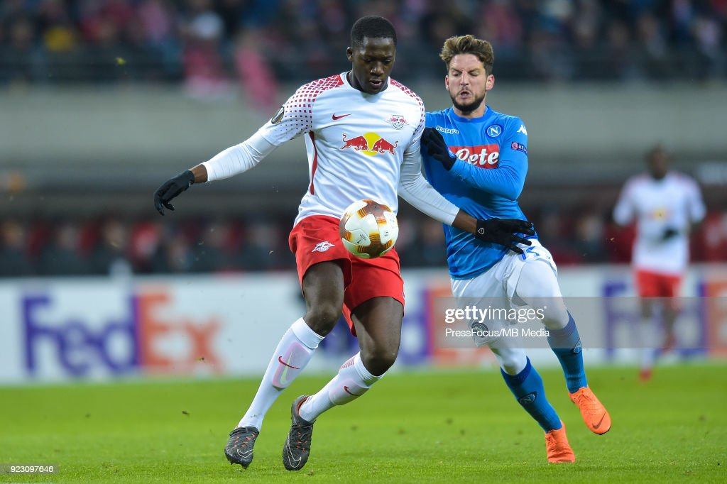 Dayot Upamecano of RB Leipzig and Dries Mertens of Napoli during UEFA Europa League Round of 32 match between RB Leipzig and Napoli at the Red Bull Arena on February 22, 2018 in Leipzig, Germany.