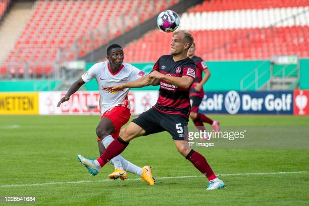 Dayot Upamecano of RB Leipzig and Johannes Geis of 1FC Nuernberg during the DFB Cup first round match between 1 FC Nuernberg and RB Leipzig at...