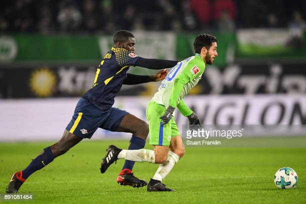 Dayot Upamecano of RB Leipzig and Yunus Malli of VfL Wolfsburg battle for the ball during the Bundesliga match between VfL Wolfsburg and RB Leipzig...