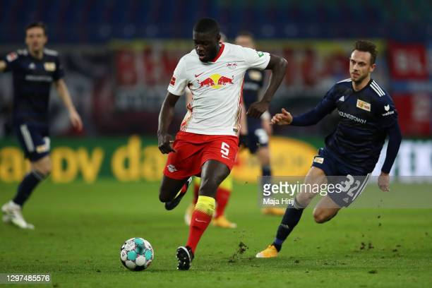 Dayot Upamecano of RB Leipzig battles for possession with Marcus Ingvartsen of 1.FC Union Berlin during the Bundesliga match between RB Leipzig and...