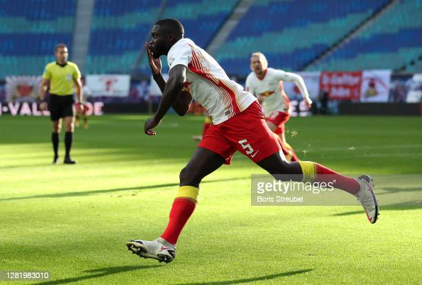 Dayot Upamecano of RB Leipzig celebrates after scoring his team's first goal during the Bundesliga match between RB Leipzig and Hertha BSC at Red...
