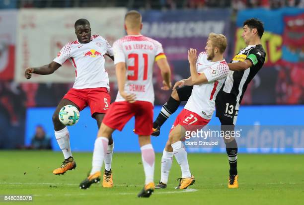 Dayot Upamecano of RB Leipzig controls the ball during the Bundesliga match between RB Leipzig and Borussia Moenchengladbach at Red Bull Arena on...