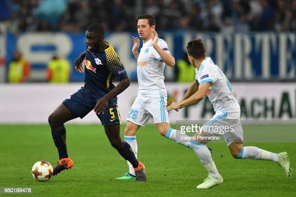 Dayot Upamecano of RB Leipzig in action against Florian Thauvin of Olympique Marseille during the UEFA Europa League quarter final leg two match...