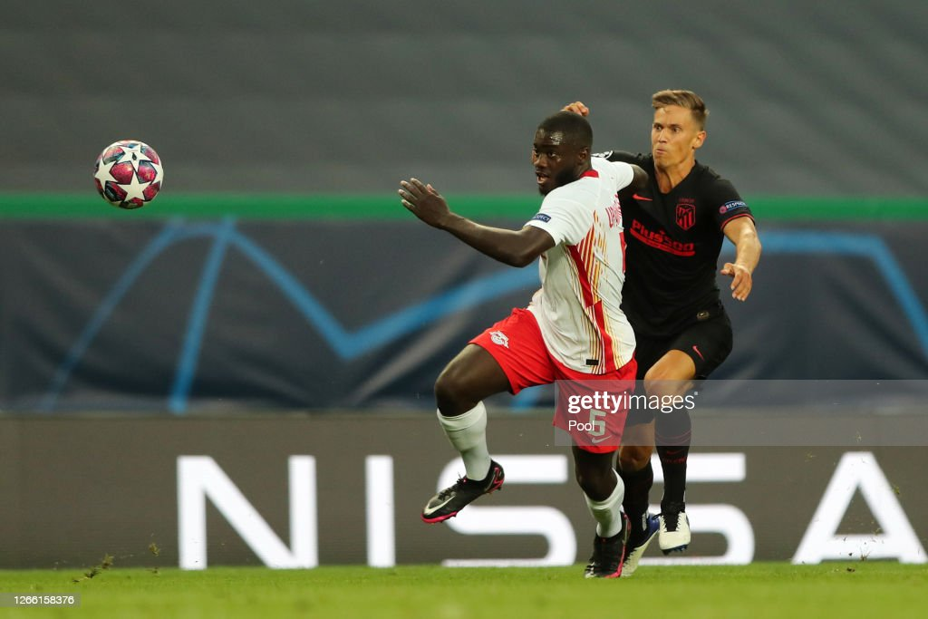 Dayot Upamecano of RB Leipzig is challenged by Marcos Llorente of ...