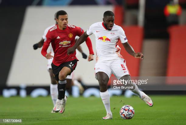 Dayot Upamecano of RB Leipzig is chased by Mason Greenwood of Manchester United during the UEFA Champions League Group H stage match between...