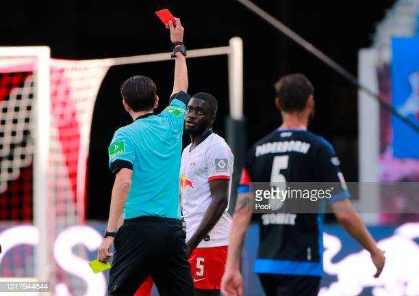 Dayot Upamecano of RB Leipzig is shown a red card by referee Deniz Aytekin during the Bundesliga match between RB Leipzig and SC Paderborn 07 at Red...