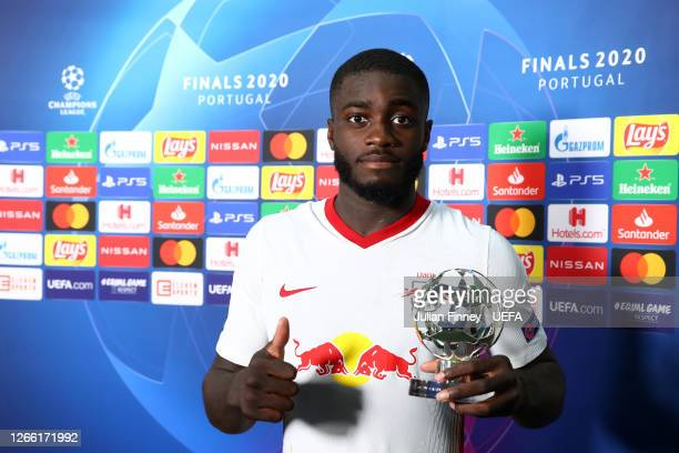 Dayot Upamecano of RB Leipzig poses for a photo with his UEFA Champions League Man of the Match award following the UEFA Champions League Quarter...