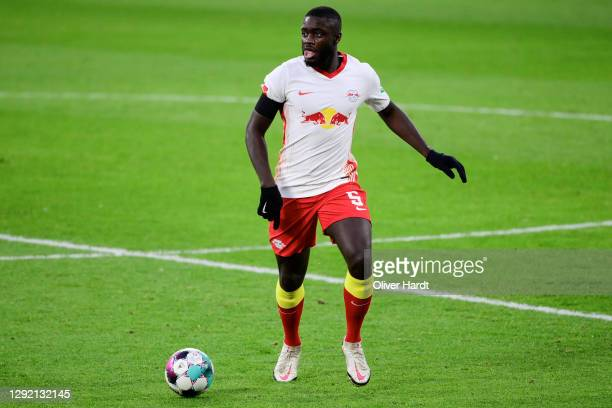 Dayot Upamecano of RB Leipzig runs with the ball during the Bundesliga match between RB Leipzig and 1. FC Koeln at Red Bull Arena on December 19,...