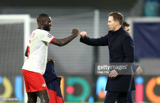 Dayot Upamecano of RB Leipzig shakes hands with Julian Nagelsmann, Head Coach of RB Leipzig after the UEFA Champions League round of 16 second leg...