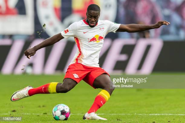 Dayot Upamecano of RB Leipzig takes a shot during the Bundesliga match between RB Leipzig and Hertha BSC at Red Bull Arena on October 24, 2020 in...