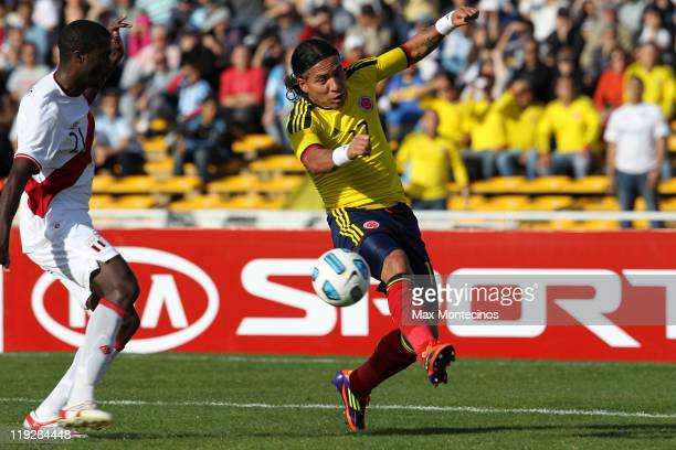 Dayro Moreno from Colombia fights for the ball with Christian Ramos from Peru During a quarter final match between Colombia and Peru at Mario Alberto...