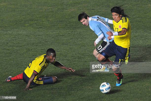 Dayro Moreno from Colombia fights for the ball with Lionel Messi during a match between Colombia and Argentina as part of the group A of the Copa...