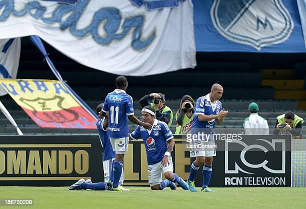 Dayro Moreno of Millonarios and his teammates celebrate a scored goal against Deportes Tolima during a match between Millonarios and Deportes...