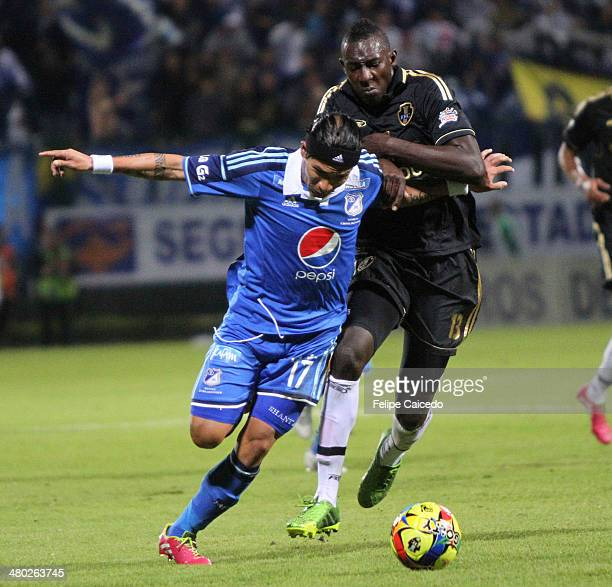 Dayro Moreno of Millonarios struggles for the ball with Dairyn Gonzalez of Fortaleza FC during a match between Millonarios and Fortaleza as part of...