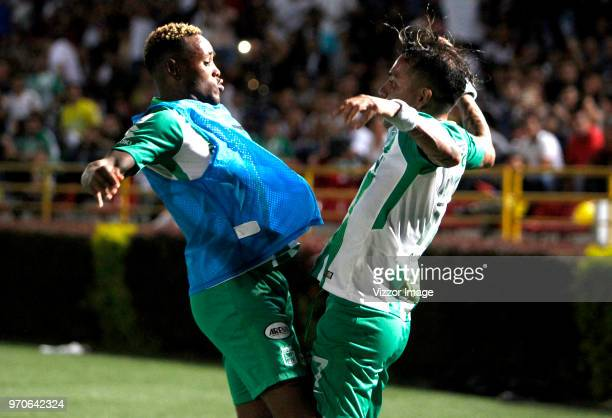 Dayro Moreno of Nacional celebrates with teammate Gustavo Torres after scoring the first goal of his team during the first leg match bewteen Deportes...