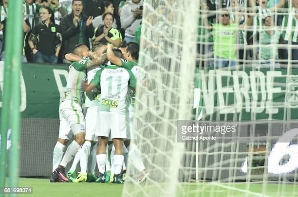 Dayro Moreno of Nacional celebrates with teammates after scoring the first goal of his team during a match between Atletico Nacional and Chapecoense...