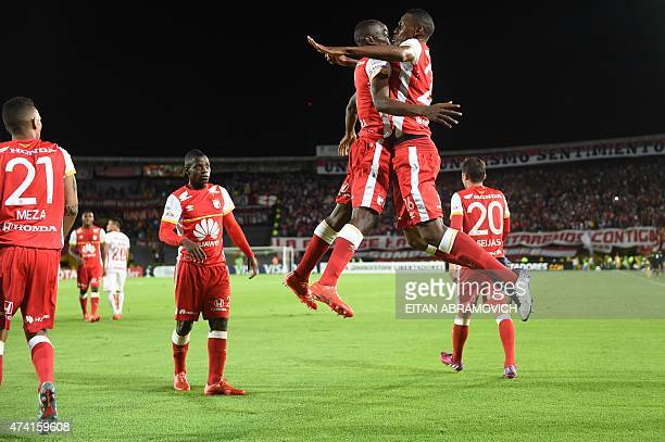Dayron Mosquera of Colombia's Santa Fe celebrates with teammate Yerry Fernando Mina after scoring a goal against Brazil's Internacional during their...