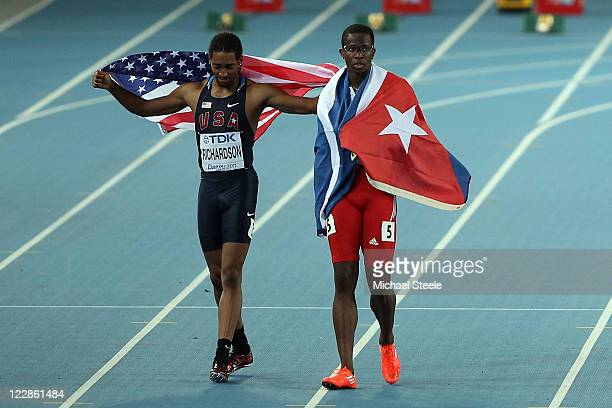 Dayron Robles of Cuba and Jason Richardson of United States celebrate after the men's 110 metres hurdles final during day three of the 13th IAAF...