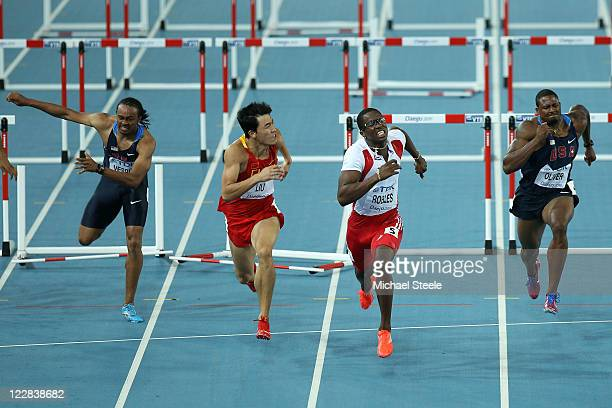 Dayron Robles of Cuba and Xiang Liu of China push for the finish line ahead of Aries Merritt of United States and David Oliver of United States...