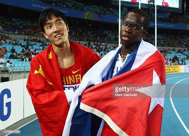 Dayron Robles of Cuba celebrates with Xiang Liu of China after the men's 110 metres hurdles final during day three of the 13th IAAF World Athletics...